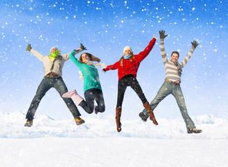 Group Of Friends Jumping in The Snow