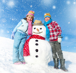 Children Having Fun with a Snowman