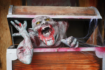 dead man in opened wooden box , halloween decoration