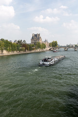 Paris - the barge  swimming with Seine toward the Royal Bridge
