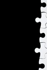 White puzzle on black background