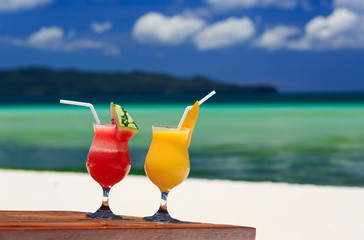 mango and watermelon cocktails on beach