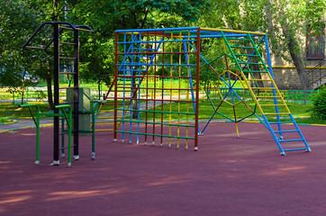 Children playground in the yard in summer