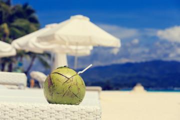 coconut drink on sand beach