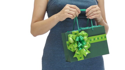 Woman Holding Green Gift Bag