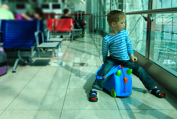 little boy waiting in the airport