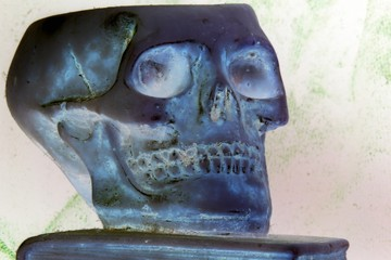 great skull above an ancient book