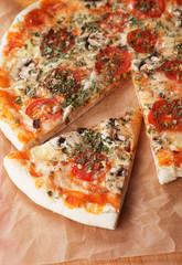 Slice of funghi pizza