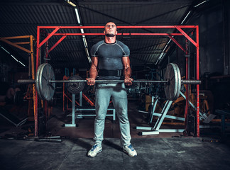 Powerlifter with strong arms lifting weights