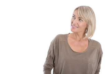 Attractive mature blond smiling woman looking sideways.