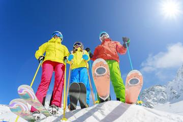 Skiing, winter, snow, skiers - family enjoying winter