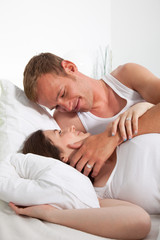 Romantic Middle Age Lying Lovers on Bed