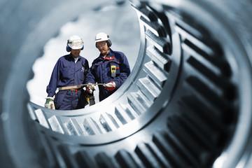 mechanics seen through a large cogwheels drum