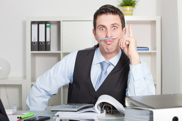 Funny Office Man Holding Pen Between Lip and Nose