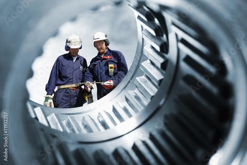 Leinwandbild Motiv mechanics seen through a large cogwheels drum