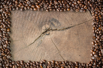 frame of coffee beans on stump background