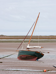 Marooned sailing boat