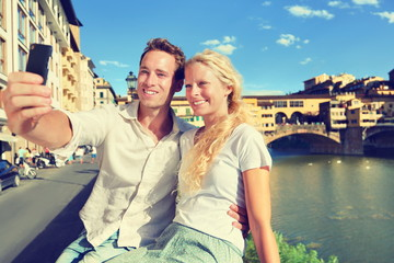 Selfie photo by couple traveling in Florence