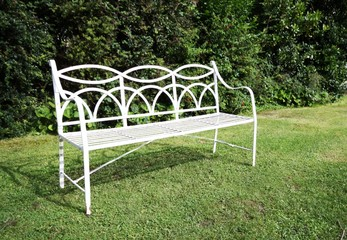 white bench in an english style garden