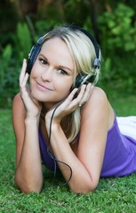 Pretty Young Blonde Lady with Earphones