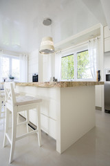 Vertical view of bright granitic kitchen island