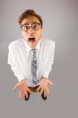 Geeky businessman gesturing to camera