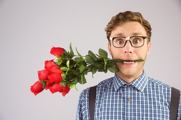 Geeky hipster biting a bunch of roses