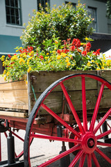 Old Wood Wagon with Red Wheel as Planter