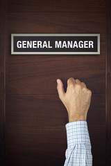 Businessman is knocking on General Manager door