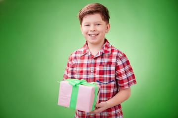 Boy holding present