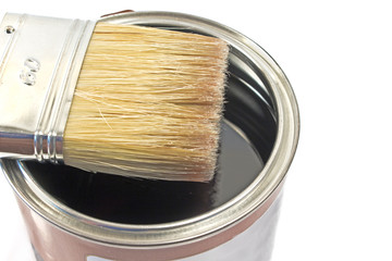 Paint brush and varnish can on white