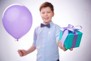 Giving present and balloon