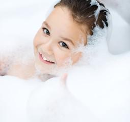 Girl bathes in a bathroom