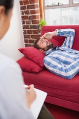 Depressed patient lying on couch