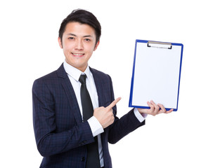 Businessman finger point to blank page of clipboard
