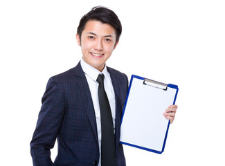 Businessman with white paper on folder