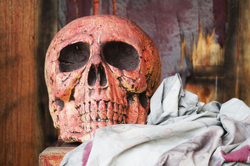 skull and dirty cloth  on wooden box ,halloween background