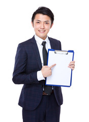 Businessman finger point to white paper of clipboard