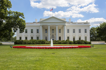 The White House in Washington. Blue sky with clouds.