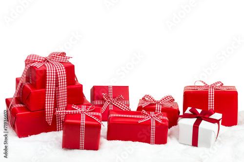 canvas print picture Weihnachtsgeschenke vor weißem Hintergrund