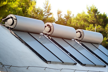solar panels and boilers for alternative water heating