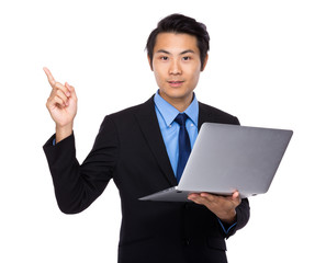 Businessman with laptop and finger point up