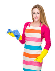Housewife with kitchen gloves and use towel