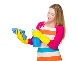 Housewife using spray and towel