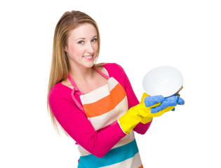 Caucasian housewife cleaning of kitchen utensil