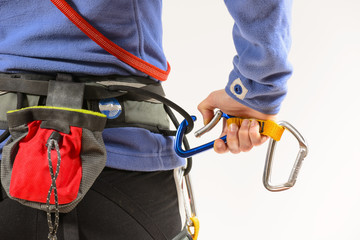 Woman wearing climbing equipment