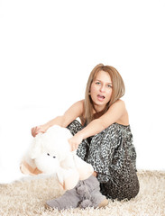 beautiful  woman wearing pajamas hugging her lamb