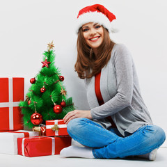 Santa girl isolated portrait with christmas gift, cristmas tree