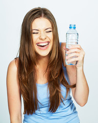 young woman drink water from blue bottle