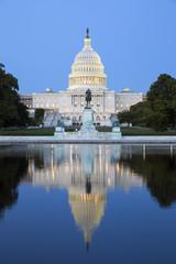 Capitol building in Washington illuminated at night.